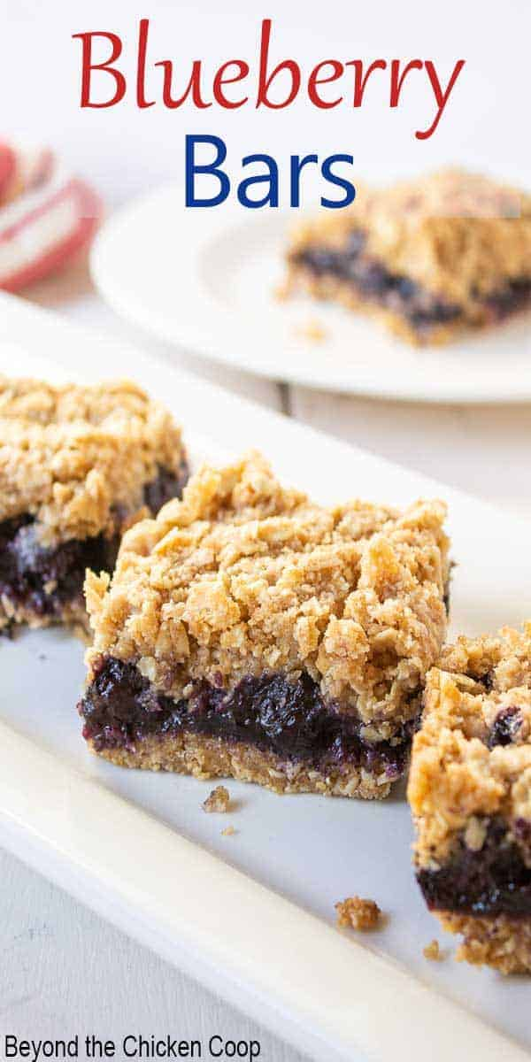 Square oat bars with a blueberry filling.