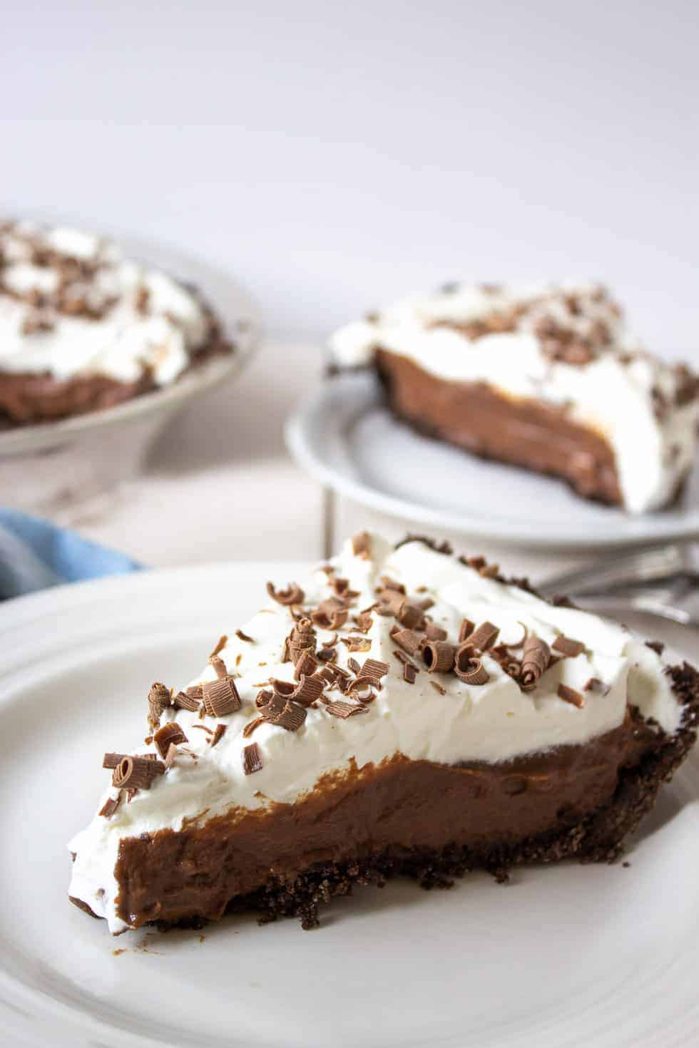 A slice of chocolate pie topped with whipped cream.