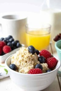 Steel Cut oats in a bowl topped with fresh berries.