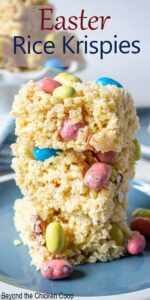 A stack of Easter rice bars with pastel colored candies.