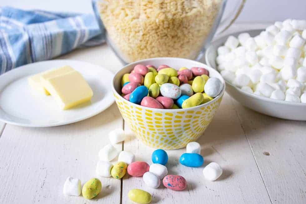 Mini malted eggs, butter, rice krispies and marshmallows all displayed on a white board.
