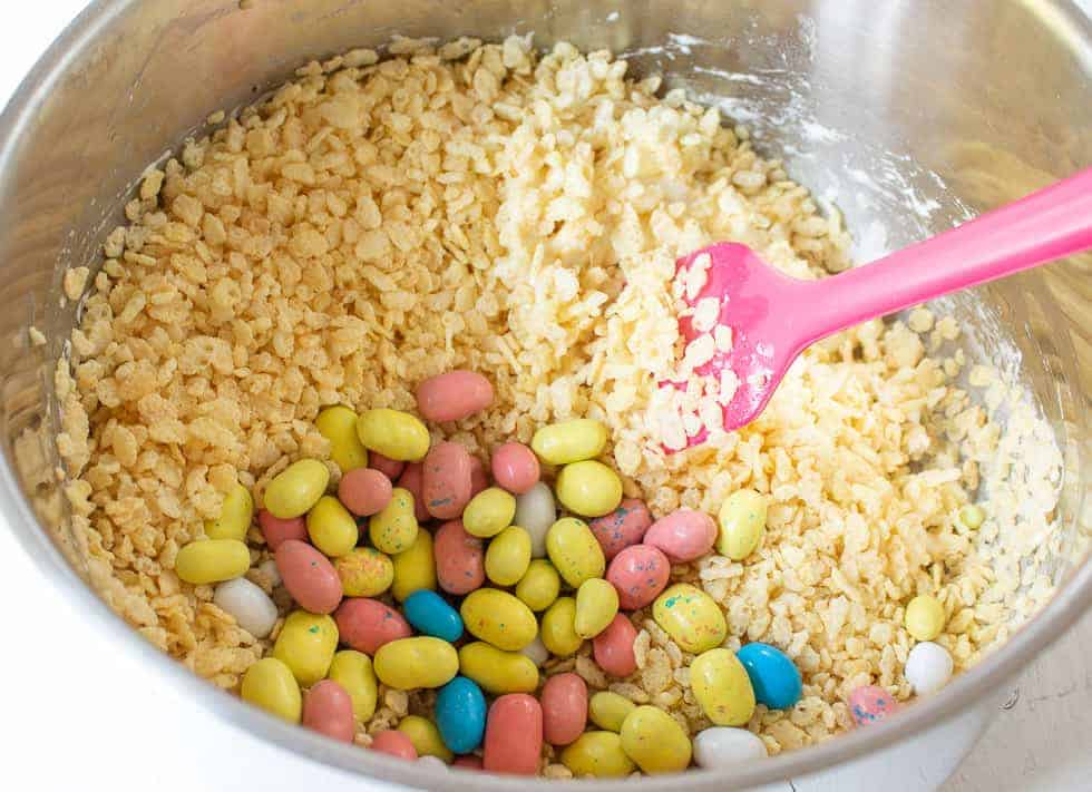 Mini melted malted colored eggs in a pot with rice Krispies.
