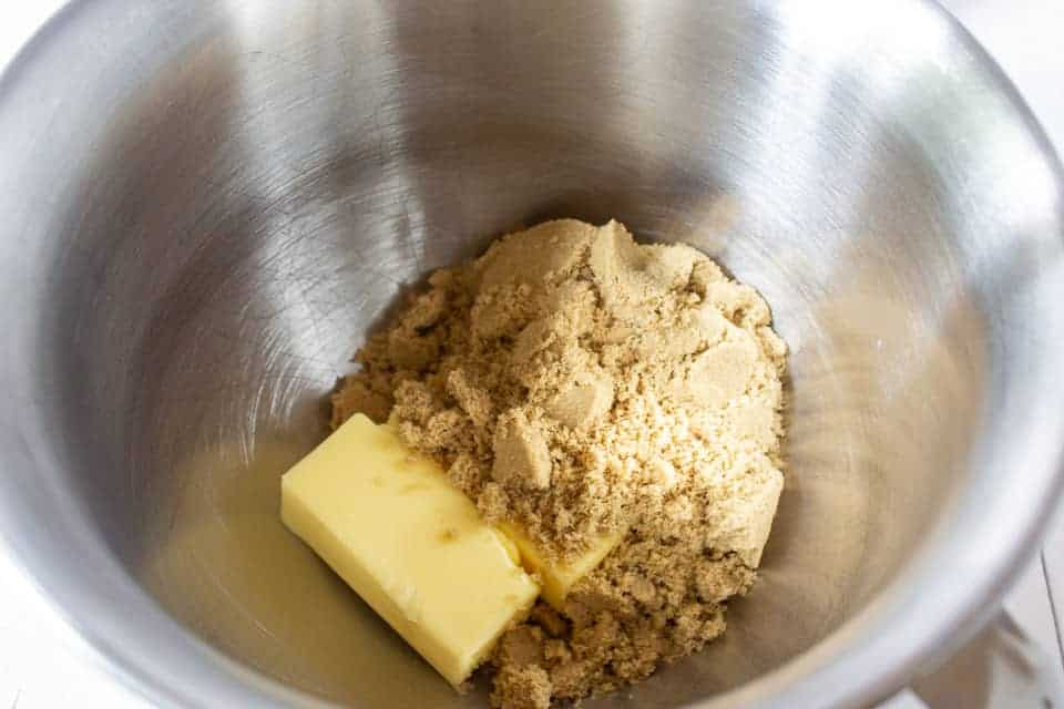 Butter and brown sugar in a mixing bowl.
