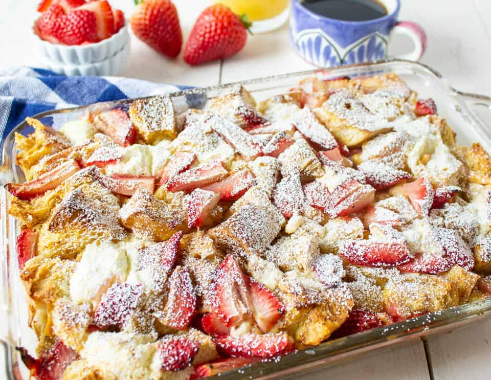 A baked french toast topped with powdered sugar.