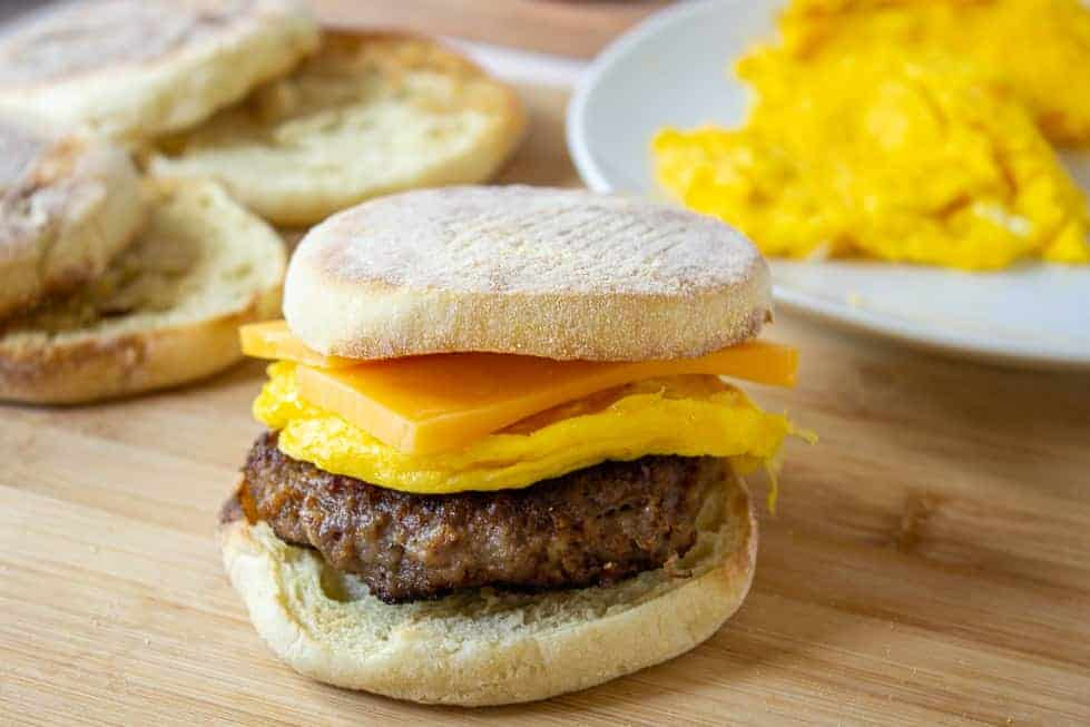 A breakfast sandwich with sausage and cheese.