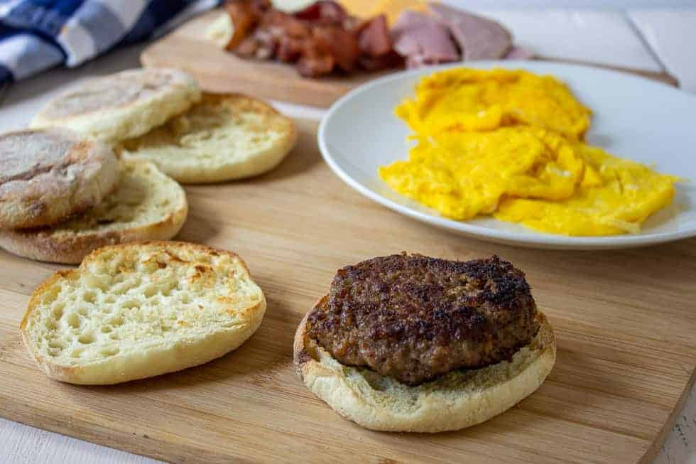 An English muffin topped with a sausage patty.