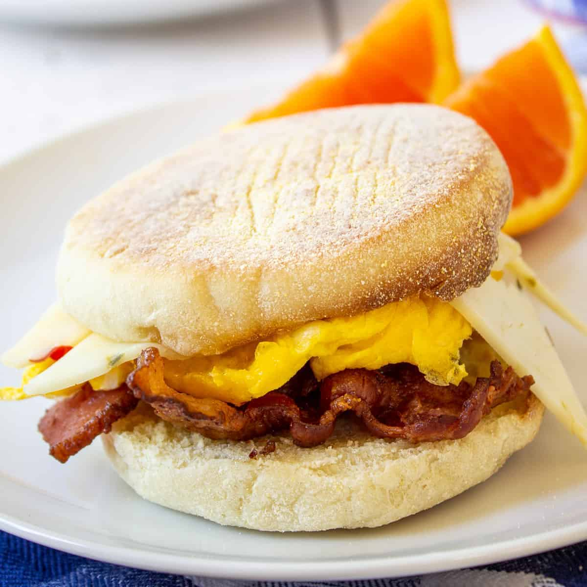 A breakfast sandwich filled with eggs, cheese and bacon.