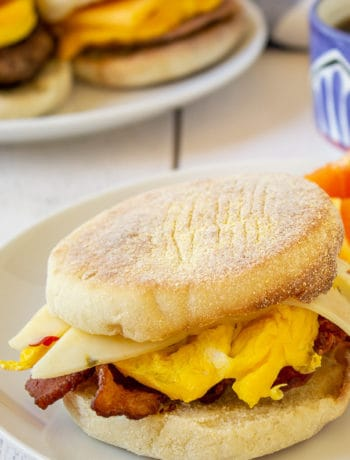English muffins with eggs, cheese and bacon.