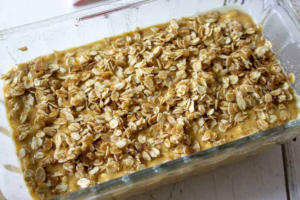 Banana bread batter topped with an oatmeal mixture.
