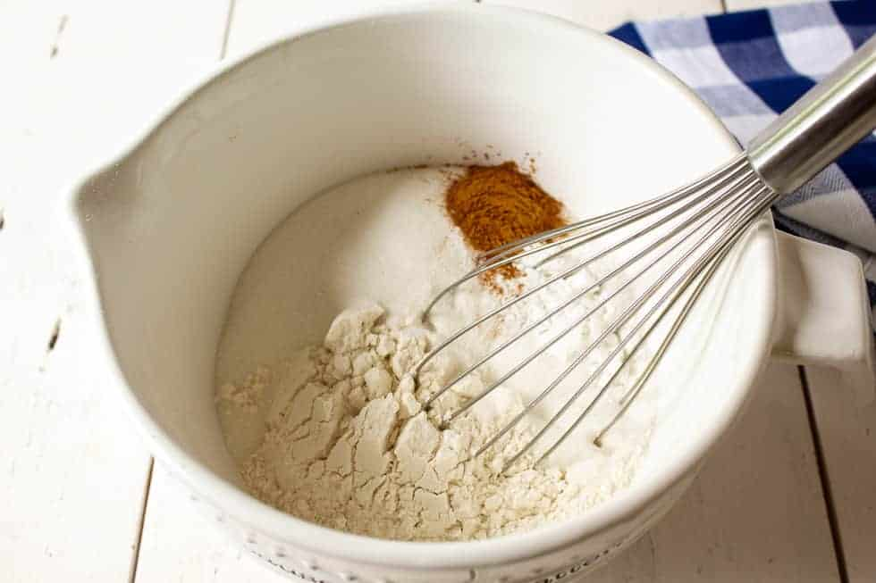 Flour with cinnamon and sugar in a bowl.