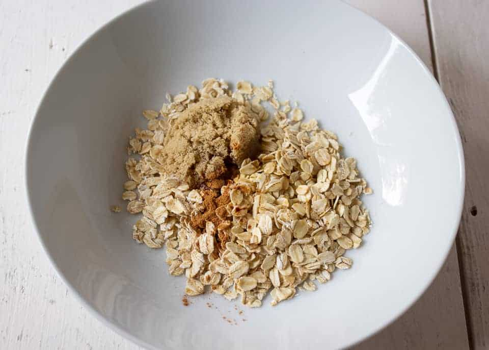 Oatmeal with brown sugar and cinnamon in a white bowl.