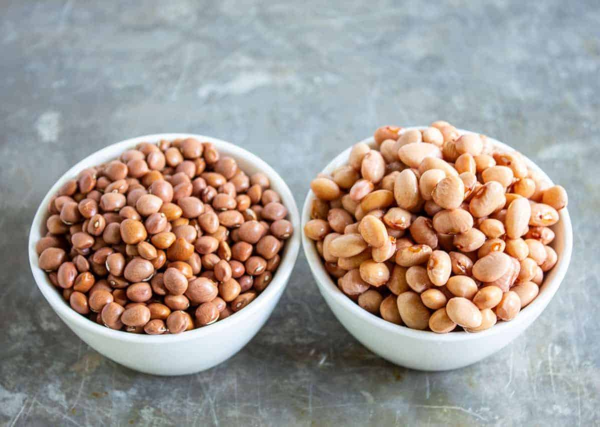 Two small bowls filled with pinquito beans.