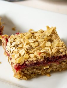 An oat bar with a raspberry jam filling.