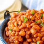 A blue pot filled with baked beans.