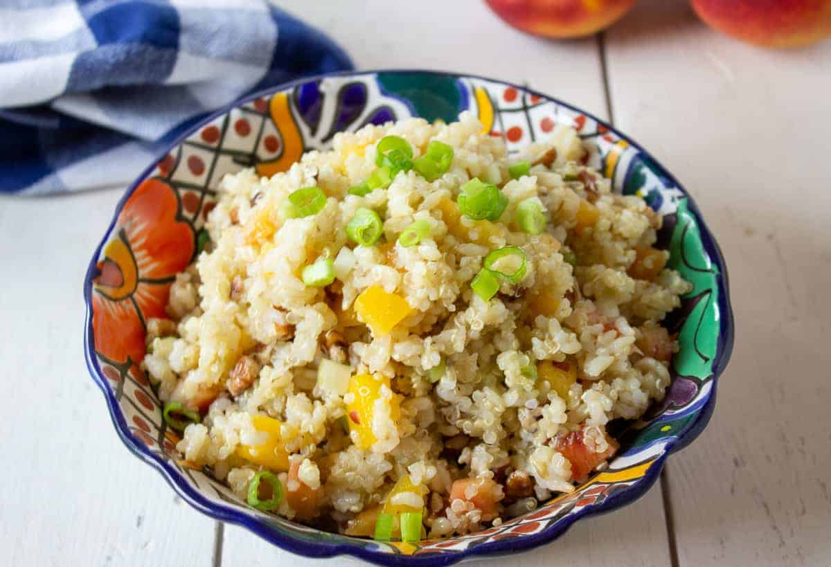 A colorful bowl filled with a quinoa and rice salad.