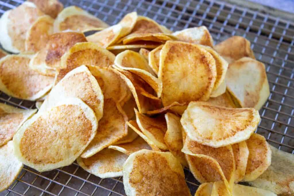 Thick cut potato chips on a baking rack.