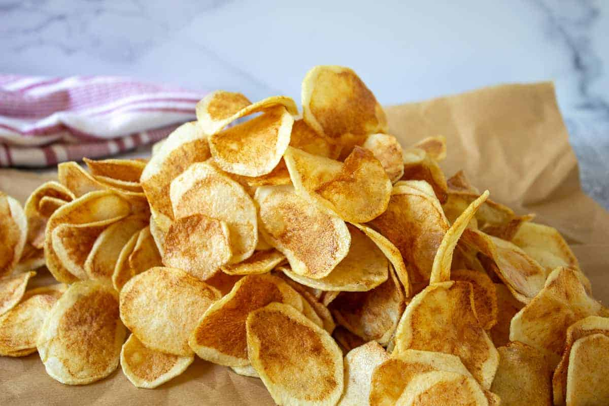 A pile of golden brown potato chips.