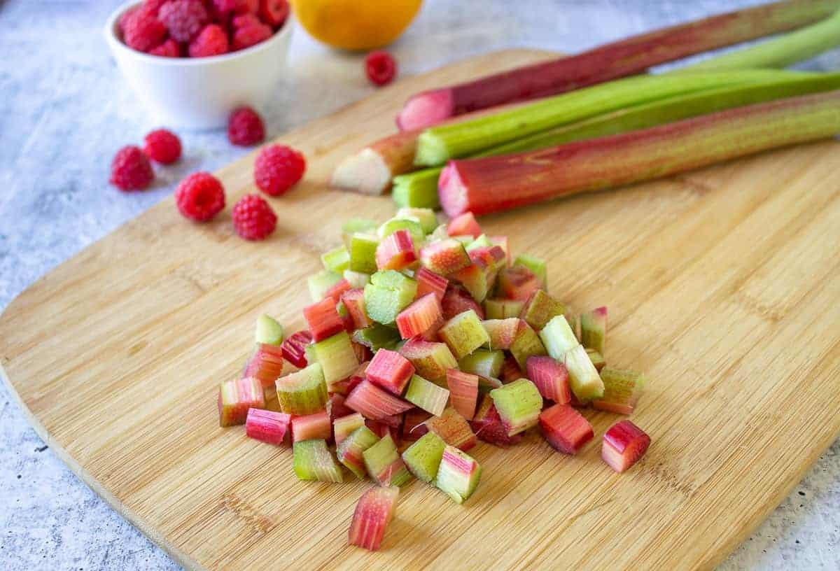 Freshly chopped rhubarb on a cutting board.