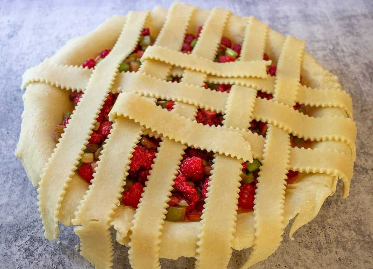 Building the top crust with lattice strips.
