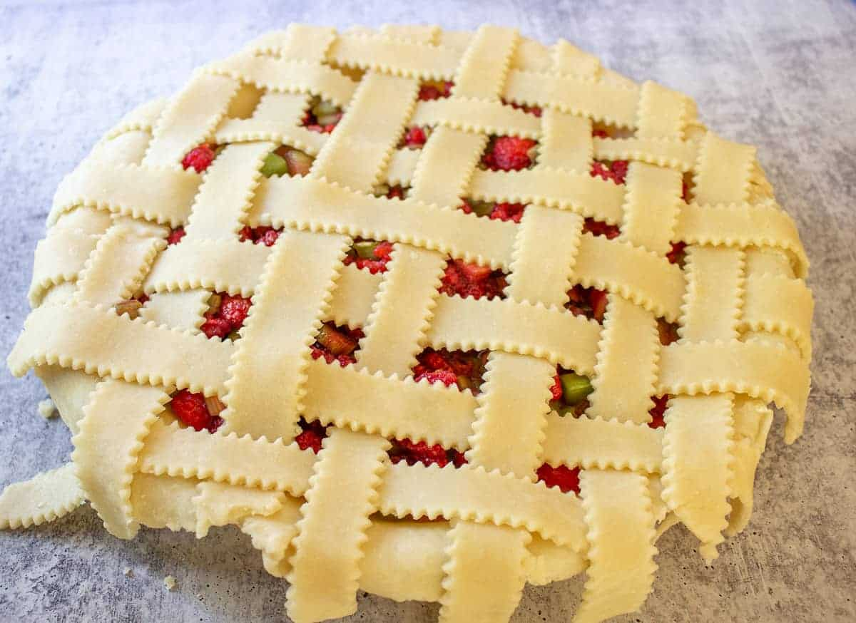 An unbaked pie with a lattice crust.