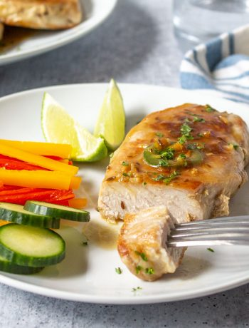 Boneless pork chop topped with a light sauce and jalapeno slices.