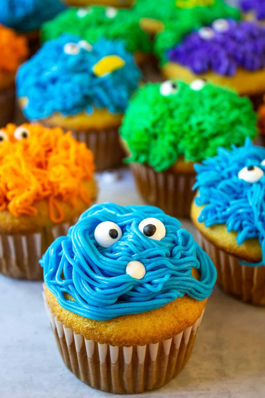 Blue, Orange and green monster cupcakes.