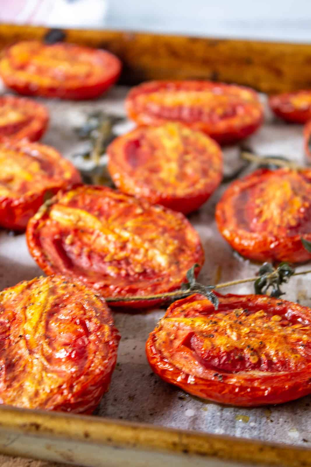 A tray full of oven roasted tomatoes.