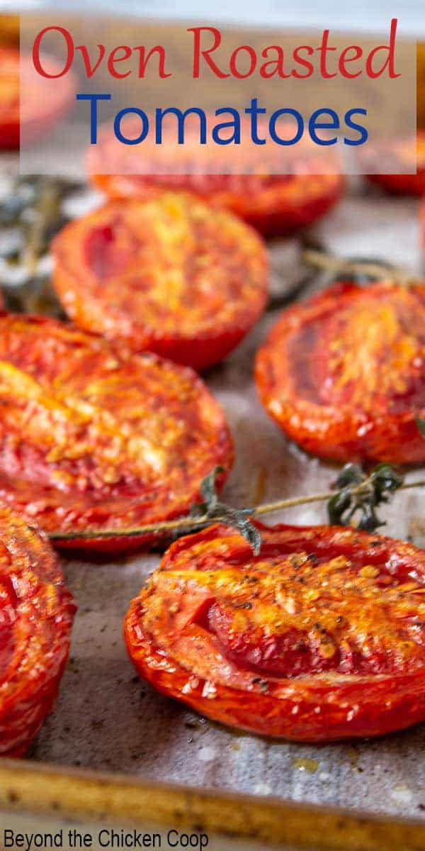 Roasted tomato slices on a baking sheet.