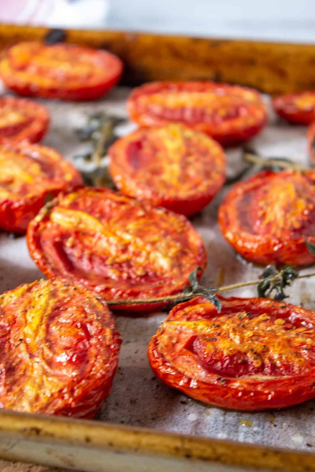 Slow roasted tomatoes on a baking sheet.