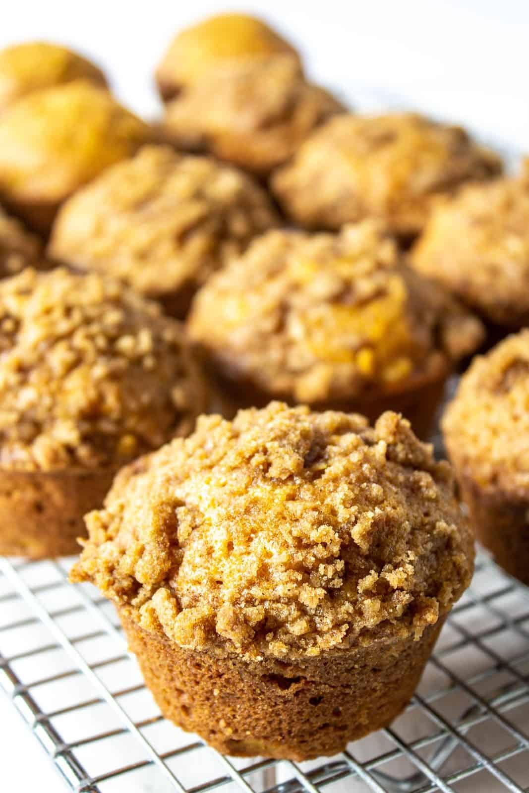 Pumpkin muffins on a baking rack.