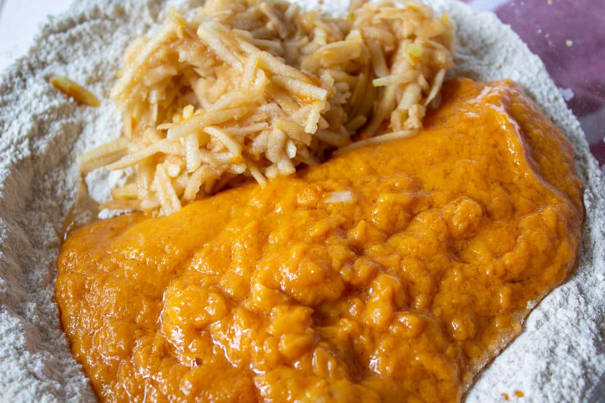 Pumpkin puree with grated apples in a bowl.