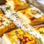 Puff pastry with eggs in the center of each pastry.