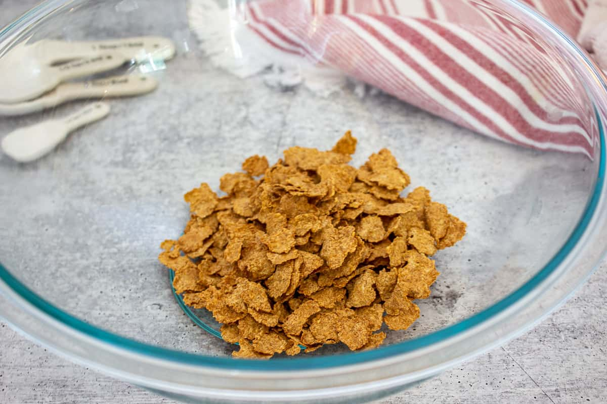 Bran flake cereal in a glass bowl.