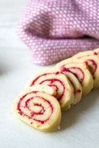 Sliced swirled cookies on a white surface.