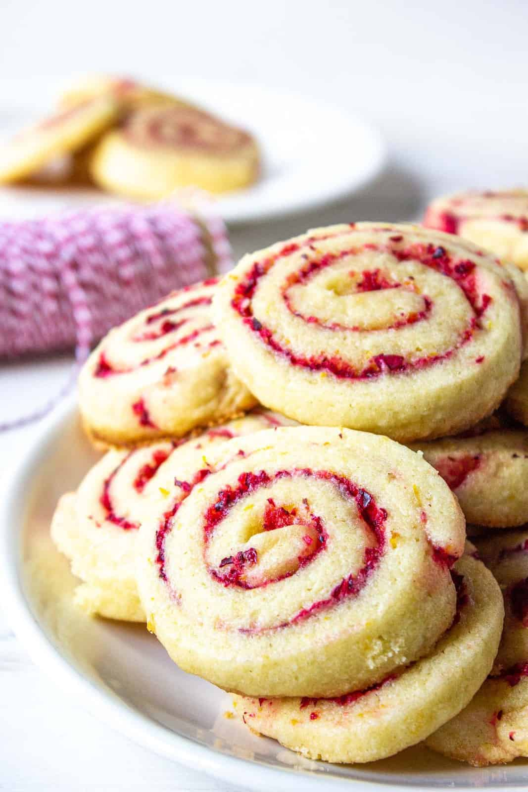 Cranberry orange cookies on a white plate.