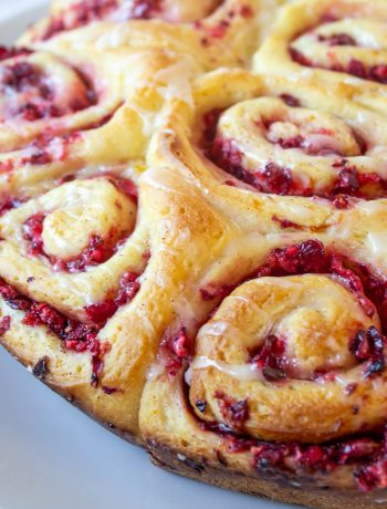 Sweet rolls with a cranberry filling on a white plate.