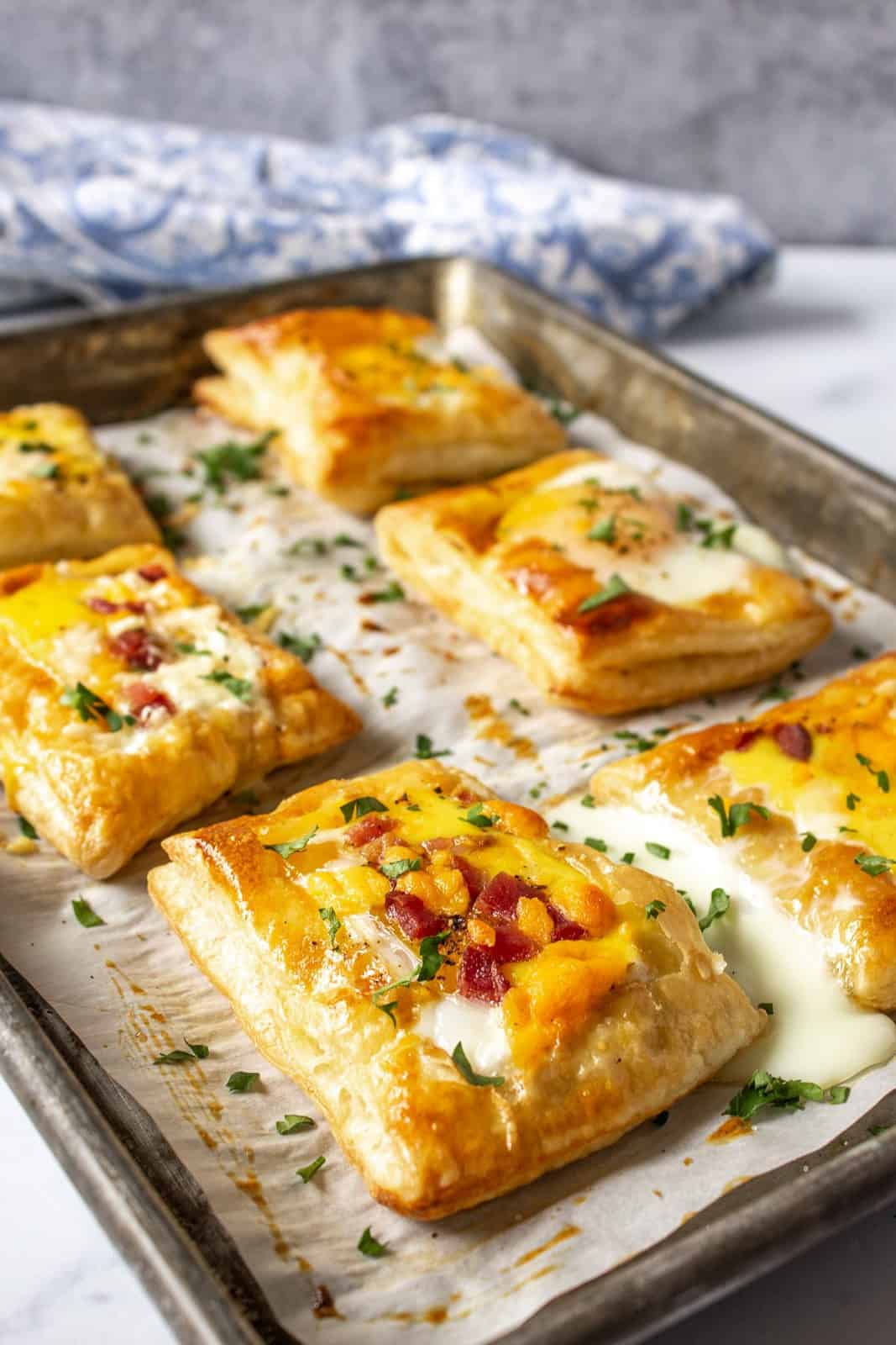 A baking sheet with puff pastry topped with baked eggs.