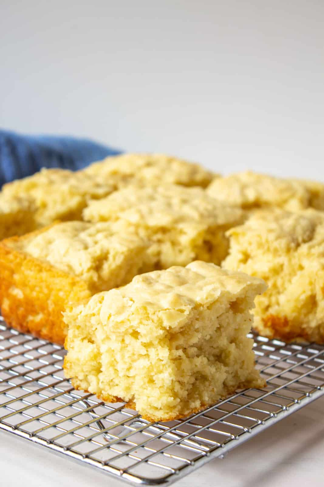 Buttermilk pan biscuits cut into squares on a wire baking rack.