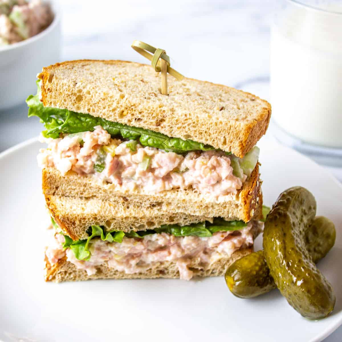 A stacked sandwich filled with deviled ham and lettuce.