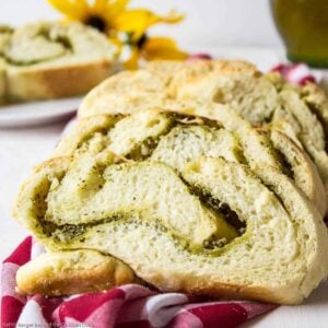 Sliced bread filled with a swirl of pesto and cheese.