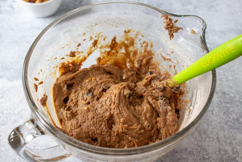 Chocolate muffin mixture in a glass bowl.