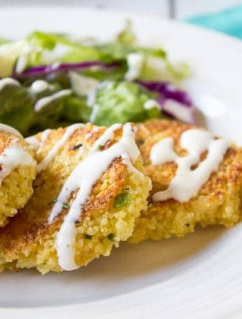 Couscous patties topped with a white drizzle.
