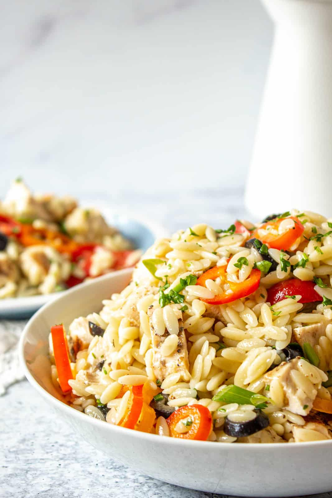 Orzo chicken salad in a large white bowl.