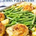 A sheet pan filled with potatoes, green beans and chicken.