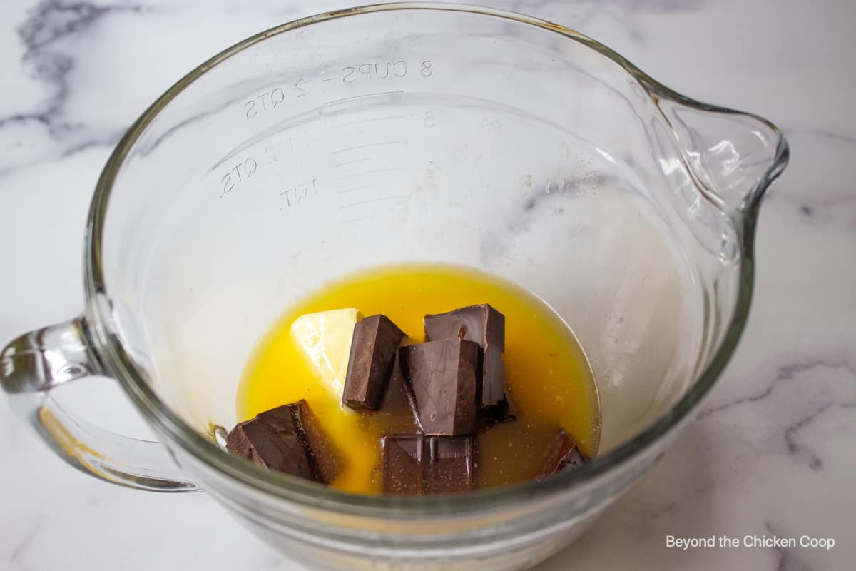 A glass bowl filled with butter and chocolate.