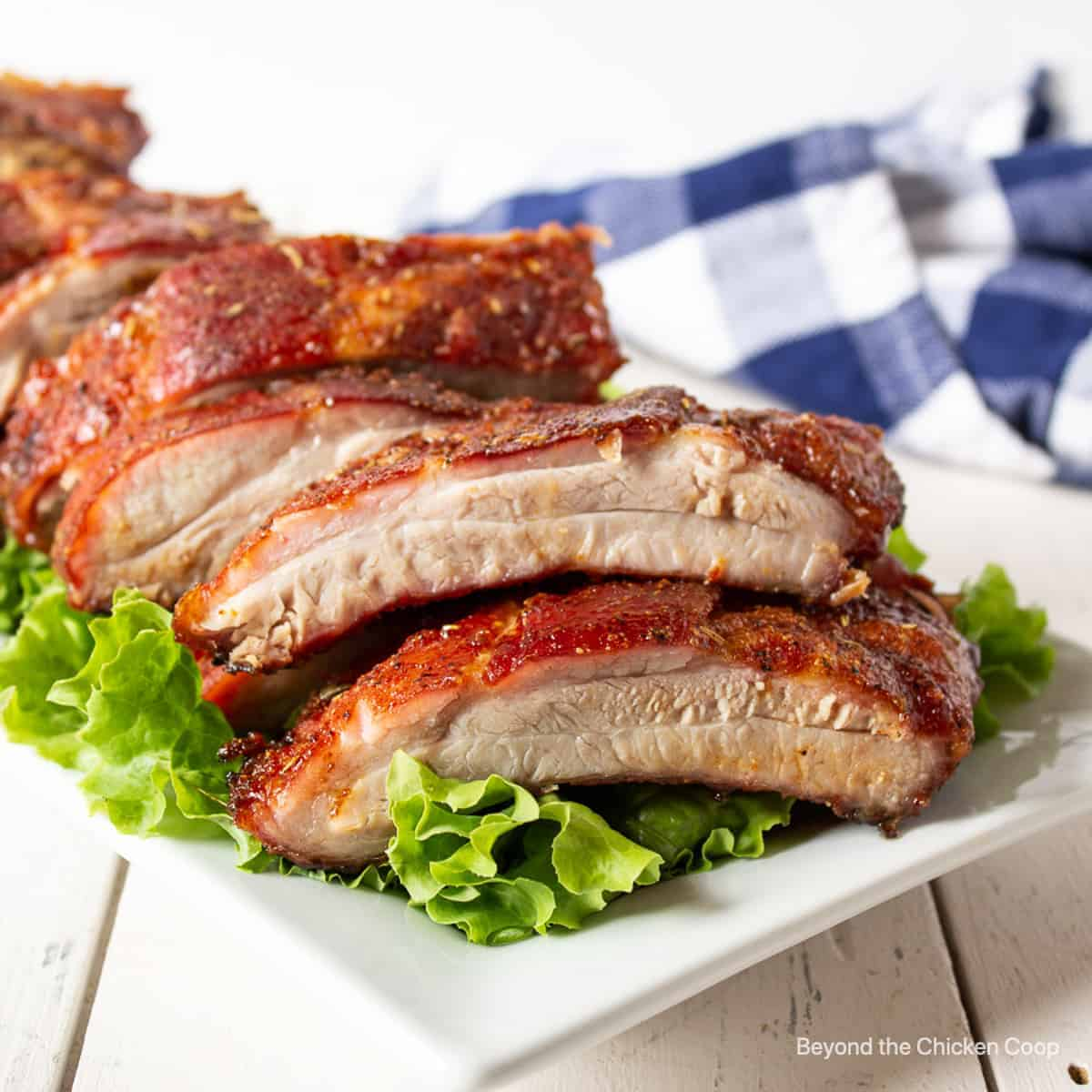 Grilled ribs on a bed of lettuce.