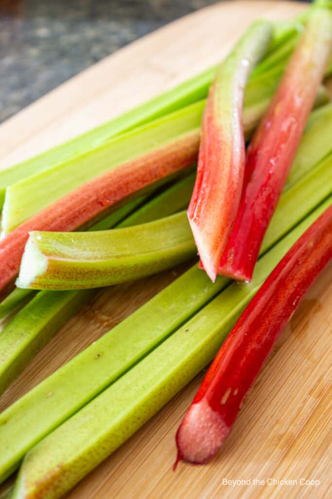 Stalks of rhubarb on a cutting board.