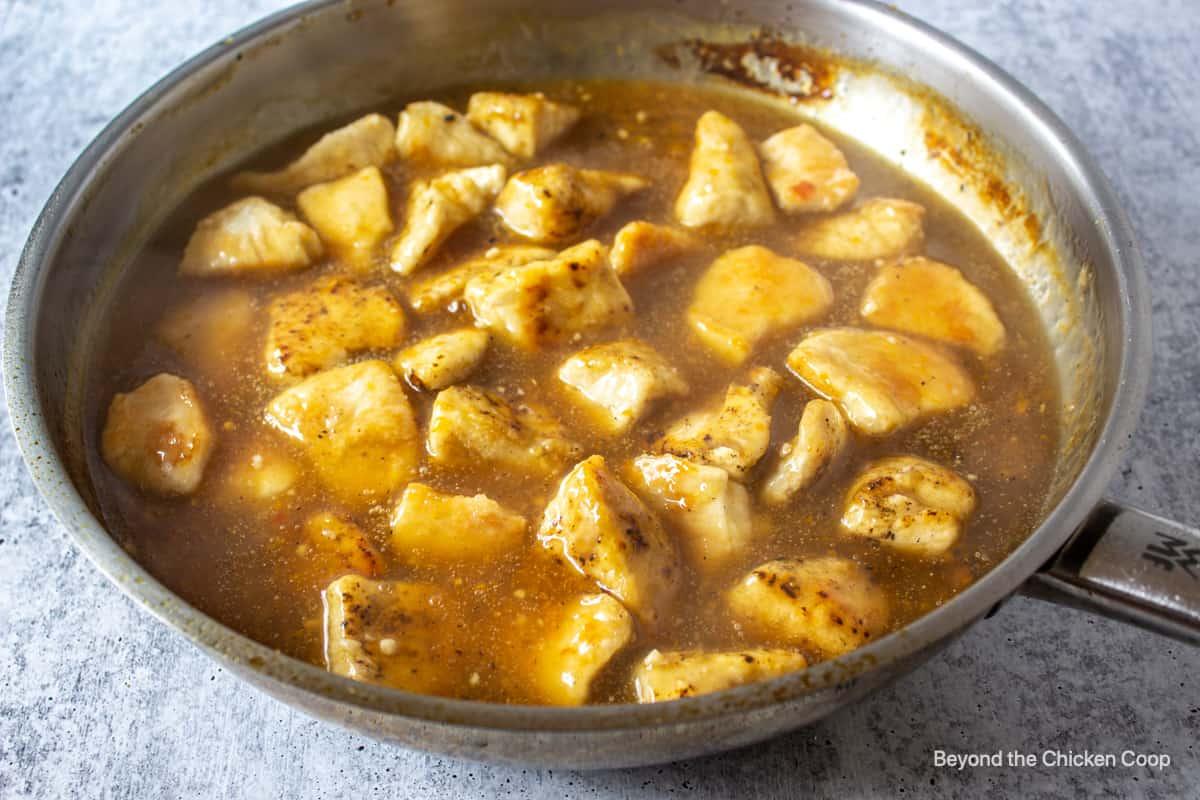 Orange chicken in a fry pan.