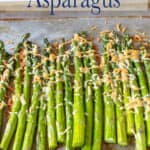 A cookie sheet lined with asparagus.