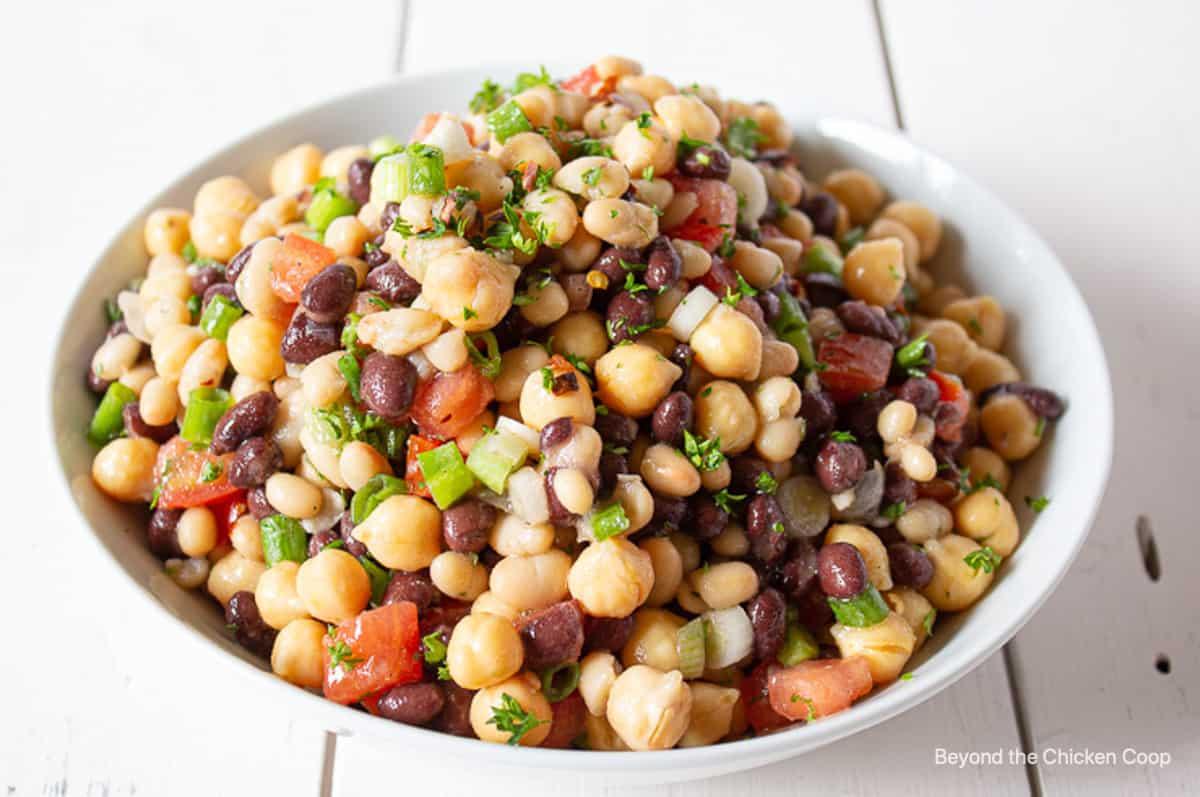 A three bean salad in a white bowl.